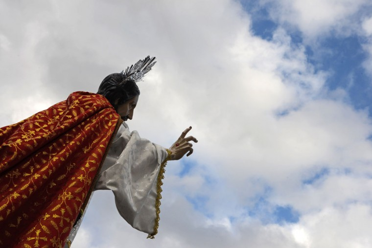 Catholics carry a statue of Jesus Christ during an Easter Sunday procession in Tegucigalpa, on April 5, 2015. (ORLANDO SIERRA/AFP/Getty Images)