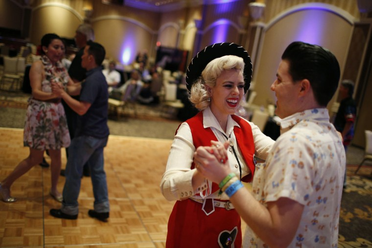 In this April 4, 2015, photo, Zack Simpson, right, and Dollie Simpson dance during a jive class at the Viva Las Vegas Rockabilly Weekend in Las Vegas. Dance classes were held for Bopping, Jiving, Strolling and the Texas Two-Step. (AP Photo/John Locher)