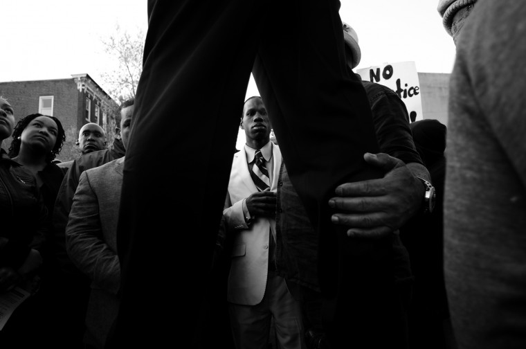 April 22: The crowd at the Western District listens to Black Lawyers for Justice President Malik Zulu Shabazz, who showed up with members of the Black Panther Party and the Nation of Islam. See more photos from the day here.