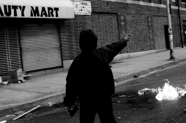 April 26: Looters destroy shops, police cars and a CVS at the corner of North and Pennsylvania avenues. The corner will become Ground Zero for the protests. See more photos from the day here.