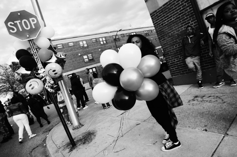 April 21: Balloons are brought to the vigil site in memory of Freddie Gray. See more photos from the day here.