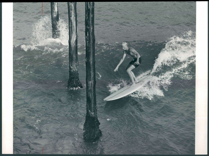 Surfer at pier, 1964.