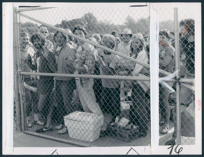 A big crowd waits for the opening of the gate at Pimlico Race Course for the 105th running of the Preakness. (Clarence B. Garrett/Baltimore Sun, 1980)