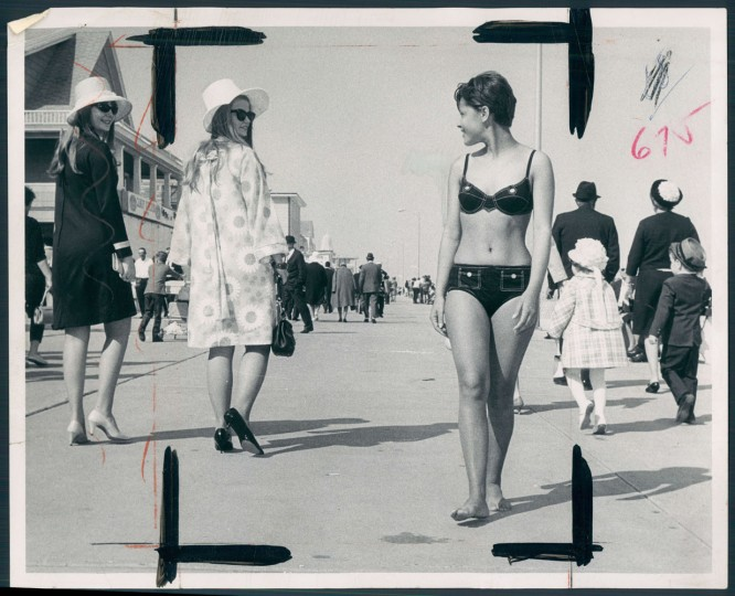 BONNETS AND BIKINIS: Finery displayed in Ocean City Easter Parade ranged from a lot to almost none at all. Wilma Beinty and Linda Bailey from Salisbury, Maryland exchange glances with Yele DaCosta of Washington D.C. during the parade in 1968.