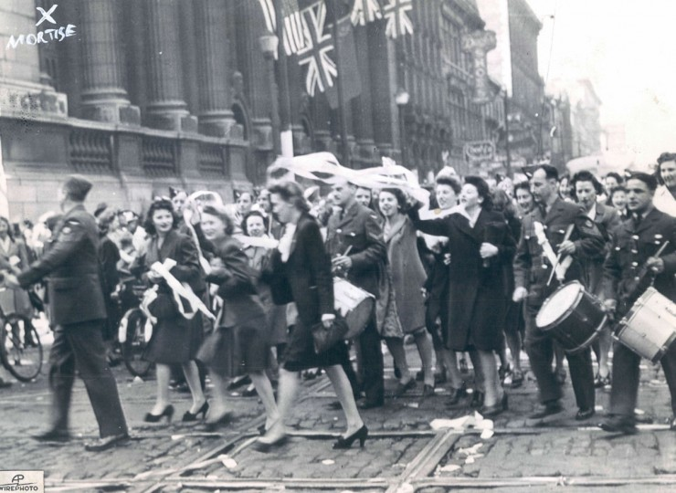 What started out as Royal Canadian AIr Force parade turned into a victory celebration when the news of Germany's surrender was flashed. (AP Wirephoto)