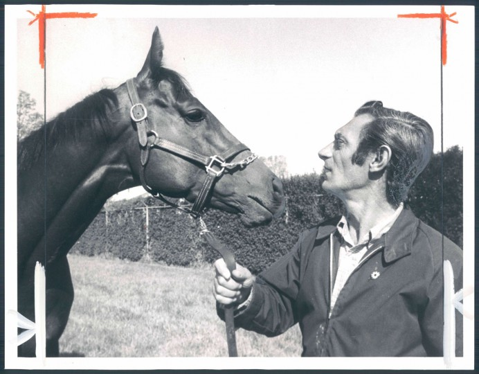 THE CHAMP - Foolish Pleasure, Kentucky Derby winner, has a little talk with rider John Nazareth at Pimlico about the kind of race he will run in the Preakness. (George H. Cook/Baltimore Sun, 1975)