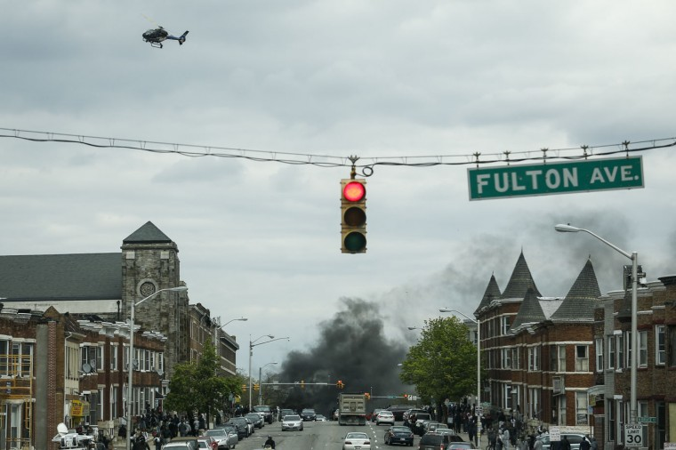 4/27/2015: Smoke billows at the intersection of Pennsylvania Avenue and North Avenue (seen from Fulton Ave), April 27, 2015 in Baltimore, Maryland. Riots have erupted in Baltimore following the funeral service for Freddie Gray, who died last week while in Baltimore Police custody. (Photo by Drew Angerer/Getty Images)