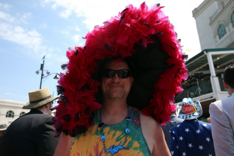 A man wearing a festive hat looks on prior to the 141st running of the Kentucky Derby at Churchill Downs on May 2, 2015 in Louisville, Kentucky. (Andy Lyons/Getty Images)