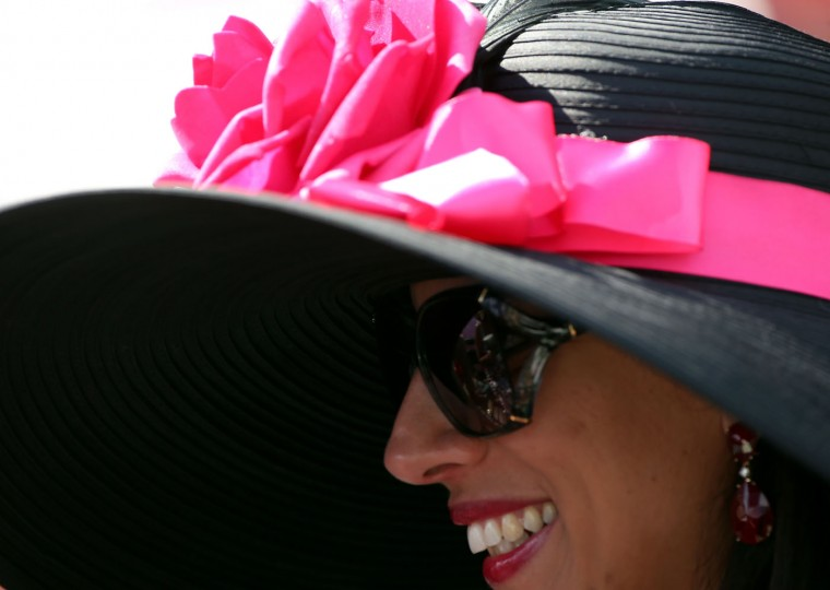A woman wearing a festive hat looks on prior to the 141st running of the Kentucky Derby at Churchill Downs on May 2, 2015 in Louisville, Kentucky. (Chris Graythen/Getty Images)