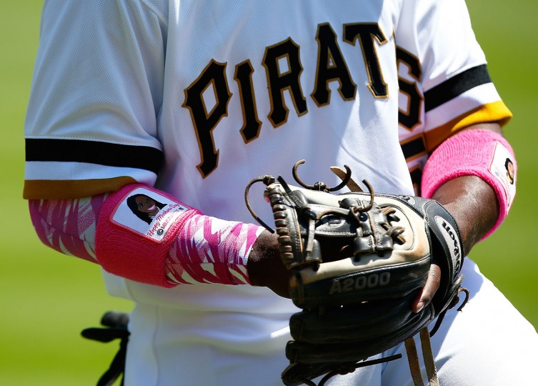 Josh Harrison #5 of the Pittsburgh Pirates warms up wearing pink sweatbands on Mother's Day prior to the game against the St Louis Cardinals at PNC Park on May 10, 2015 in Pittsburgh, Pennsylvania. (Jared Wickerham/Getty Images)