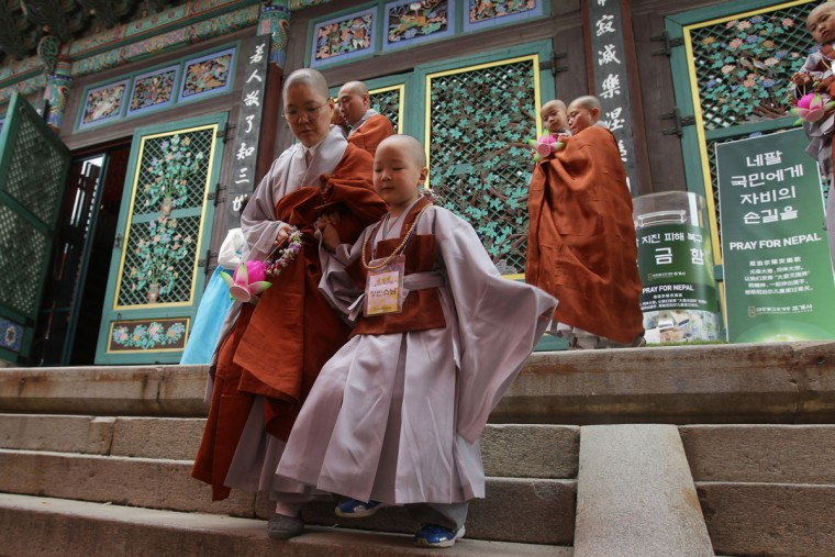 Children attend the 'Children Becoming Buddhist Monks' ceremony forthcoming buddha's birthday at a Chogye temple on May 11, 2015 in Seoul, South Korea. Children have their hair shaved off during the 'Children Becoming Buddhist Monks' ceremony ahead of buddha's birthday at a Chogye temple. The children will stay at the temple to learn about Buddhism for 14 days. Buddha was born approximately 2,559 years ago, and although the exact date is unknown, Buddha's official birthday is celebrated on the full moon in May in South Korea, which is on May 25 this year. (Photo by Chung Sung-Jun/Getty Images)