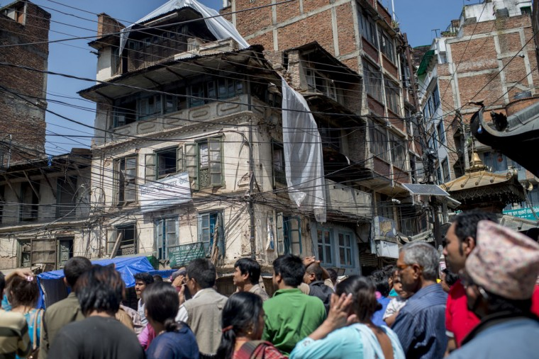 People gather in the safety of open space following a further major earthquake on May 12, 2015 in Kathmandu, Nepal. A 7.3 magnitude earthquake has struck in Nepal only two weeks after more than 8,000 people were killed in a devastating earthquake. The latest quake has struck near Mt Everest near the town of Namche Bazar. Tremors have been felt as far away as Bangladesh and Delhi. (Photo by Jonas Gratzer/Getty Images)