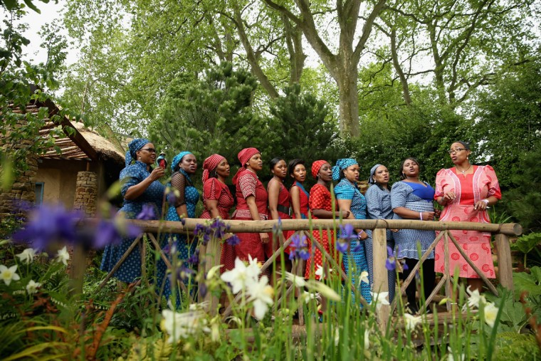 Basotho singers from Lesotho sing in the Sentebale 'Hope In Vunerability' Garden during the annual Chelsea Flower show at Royal Hospital Chelsea on May 18, 2015 in London, England.The Sentebale - Hope In Vulnerability Garden at RHS Chelsea Flower Show was designed by Matt Keightley and is inspired by the Mamohato Children's Centre in Lesotho. The Children's Centre is due to open later this year in Lesotho and will provide support to children living wth HIV (Photo by Chris Jackson/Getty Images for Sentebale)