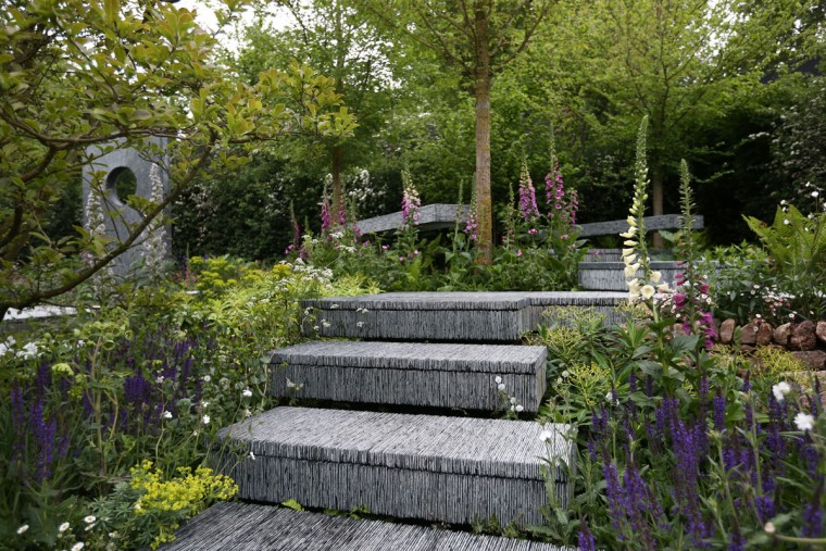 The Brewin Dolphin show garden designed by Darren Hawkes Landscapes and sponsored by Brewin Dolphin is pictured on the press preview day of the Chelsea Flower Show on May 18, 2015 in London, England. The show, which has run annually since 1913 in the grounds of the Royal Hospital Chelsea, is open to the public from 19th to 23rd May and is expected to draw around 157,000 visitors. (Photo by Carl Court/Getty Images)