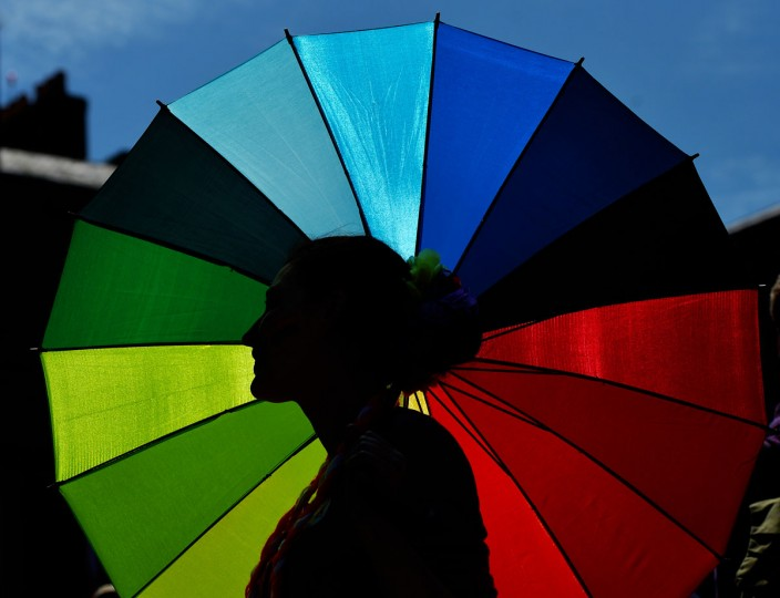 A supporter in favour of same-sex marriage stands under a rainbow umbrella as thousands gather in Dublin Castle square awaiting the vote outcome on May 23, 2015 in Dublin, Ireland. Voters in the Republic of Ireland are taking part in a referendum on legalising same-sex marriage on Friday. The referendum was held 22 years after Ireland decriminalised homosexuality with more than 3.2m people being asked whether they want to amend the country's constitution to allow gay and lesbian couples to marry. (Photo by Charles McQuillan/Getty Images)