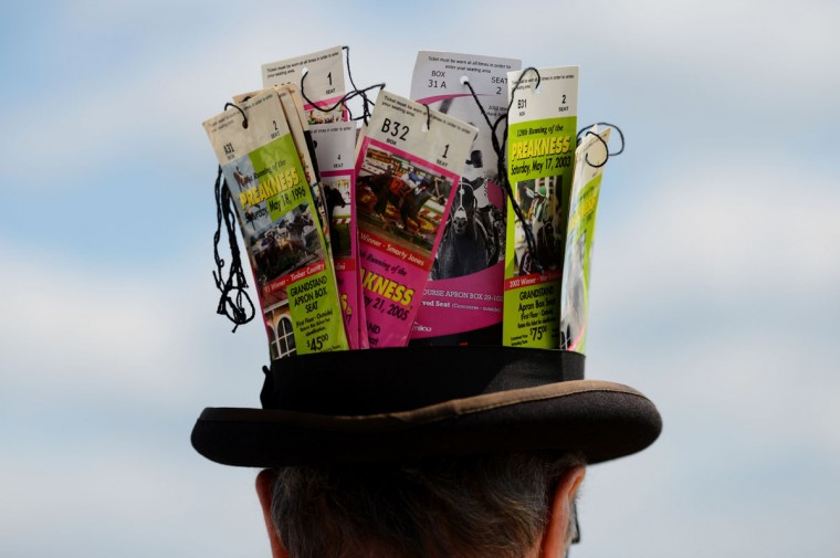 A man wears a hat with tickets during the 139th running of the Preakness Stakes at Pimlico Race Course on May 17, 2014 in Baltimore, Maryland. (Photo by Molly Riley/Getty Images)