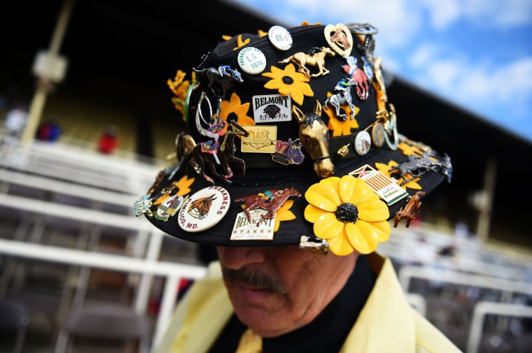 A man wears a decorative hat prior to the 139th running of the Preakness Stakes at Pimlico Race Course on May 17, 2014 in Baltimore, Maryland. (Photo by Patrick Smith/Getty Images)