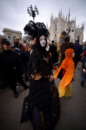"A cosplayer dressed as Padme Amidala of ""Star Wars"" stands in front of Milan's Duomo on May 3, 2015 as part of Star Wars Day. (AFP Photo/Filippo Monteforte)"
