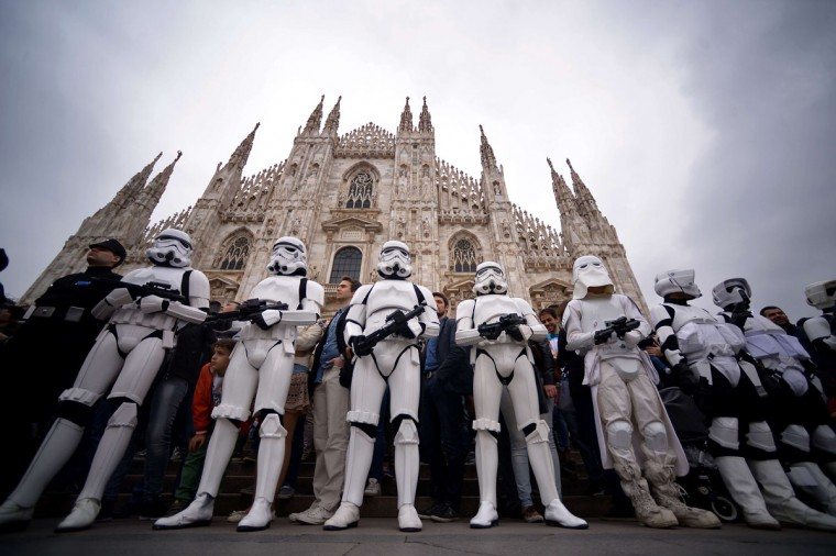 "Cosplayers dressed as ""Star Wars"" stormtroopers stand in front of Milan's Duomo on May 3, 2015 as part of Star Wars Day. (AFP Photo/Filippo Monteforte)"