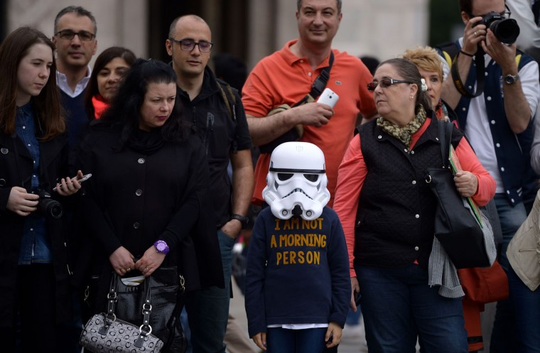 "A young ""Star Wars"" fan wearing a stormtrooper helmet attends an event marking Star Wars Day in Milan on May 3, 2015. (AFP Photo/Filippo Monteforte)"