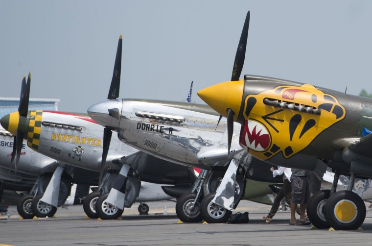 P-51 World War II era aircraft sit on the tarmac as dozens of World War II era airplanes gather Culpeper Regional Airport in Brandy Station, Virginia, May 7, 2015. The planes will fly past the National Mall in Washington, DC, on May 8, during the Arsenal of Democracy World War II Victory Capitol Flyover to commemorate the 70th anniversary of Victory in Europe (VE) Day. (Saul Loeb/AFP/Getty Images)