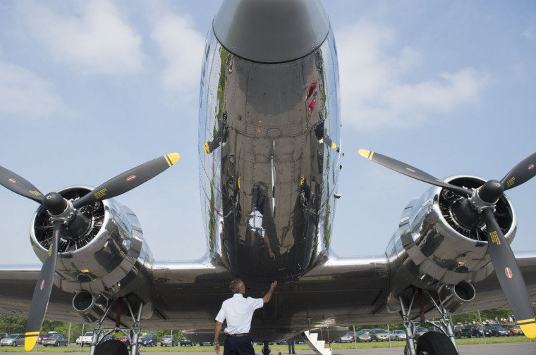 Dan Gleason completes a preflight check of a Douglas C-47 Skytrain airplane prior to a practice flight with dozens of World War II era aircraft at Culpeper Regional Airport in Brandy Station, Virginia, May 7, 2015. Dozens of World War II era planes will fly past the National Mall in Washington, DC, on May 8, during the Arsenal of Democracy World War II Victory Capitol Flyover to commemorate the 70th anniversary of Victory in Europe (VE) Day. (Saul Loeb/AFP/Getty Images)