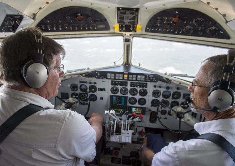 Pilot and owner Karl Stoltzfu flies a Douglas C-47 Skytrain airplane with co-pilot Dan Gleason (R) during a practice flight with dozens of World War II era aircraft near Culpeper Regional Airport in Brandy Station, Virginia, May 7, 2015. Dozens of World War II era planes will fly past the National Mall in Washington, DC, on May 8, during the Arsenal of Democracy World War II Victory Capitol Flyover to commemorate the 70th anniversary of Victory in Europe (VE) Day. (Saul Loeb/AFP/Getty Images)
