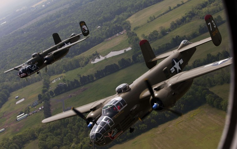 Two B-25 Mitchell bombers fly in formation with dozens of other World War II era aircraft over Culpeper Regional Airport in Brandy Station, Virginia, May 7, 2015. Dozens of World War II era planes will fly past the National Mall in Washington, DC, on May 8, during the Arsenal of Democracy World War II Victory Capitol Flyover to commemorate the 70th anniversary of Victory in Europe (VE) Day. (Andrew Caballero-Reynolds/AFP/Getty Images)