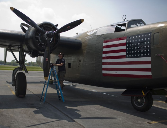 A crew member for a B-24 bomber checks the engines after a practice flight with dozens of World War II era aircraft at Manassas Regional Airport, Virginia, May 7, 2015. Dozens of World War II era planes will fly past the National Mall in Washington, DC, on May 8, during the Arsenal of Democracy World War II Victory Capitol Flyover to commemorate the 70th anniversary of Victory in Europe (VE) Day. (Andrew Caballero-Reynolds/AFP/Getty Images)