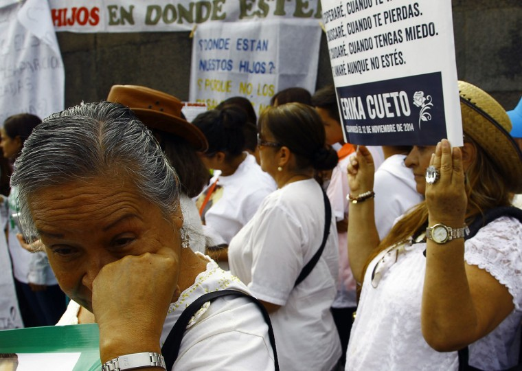 Relatives of missing people show allusive signs of their loved ones during a demonstration commemorating Mother's Day in Guadalajara, Mexico on May 10, 2015. Civil societies estimate that there are more than 30,000 people missing in Mexico due to violence. (Hector Guerrero/AFP/Getty Images)