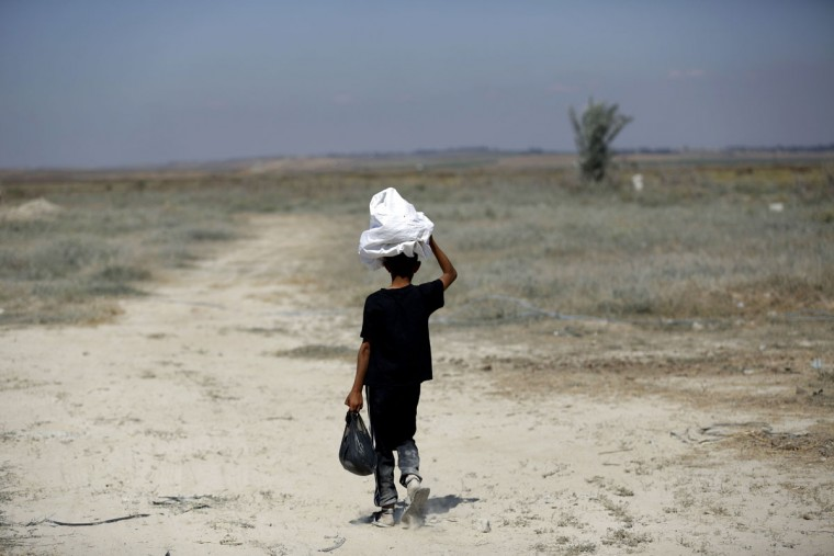 "A Palestinian boy walks in the Gaza Strip near the Nahal Oz border crossing with Israel as Palestinians mark the 67th anniversary of the ""Nakba"" on May 15, 2015. ""Nakba"" means in Arabic ""catastrophe"" in reference to the birth of the state of Israel 67-years-ago in British-mandate Palestine, which led to the displacement of hundreds of thousands of Palestinians who either fled or were driven out of their homes during the 1948 war over Israel's creation. (MOHAMMED ABED/AFP/Getty Images)"