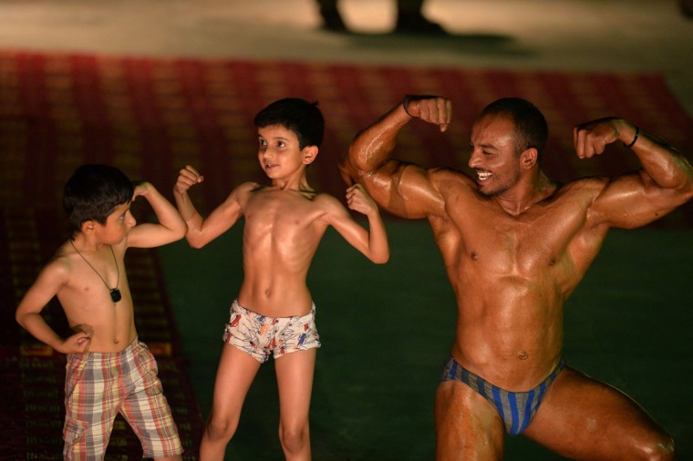 A Pakistani bodybuilder competes during a local Mr. Islamabad and junior Mr Islamabad competition in Islamabad on May 15, 2015. (AAMIR QURESHI/AFP/Getty Images)