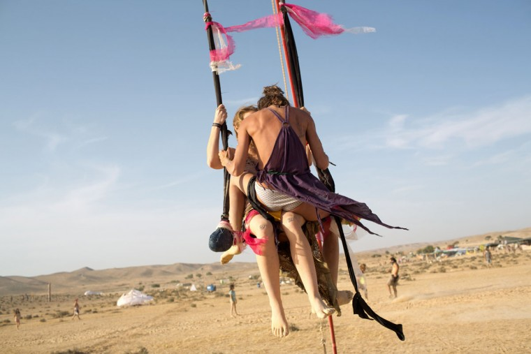 A couple sit on a swing during the 2015 Midburn festival in the Negev Desert near the Israeli kibbutz of Sde Boker on May 22, 2015. (MENAHEM KAHANA/AFP/Getty Images)
