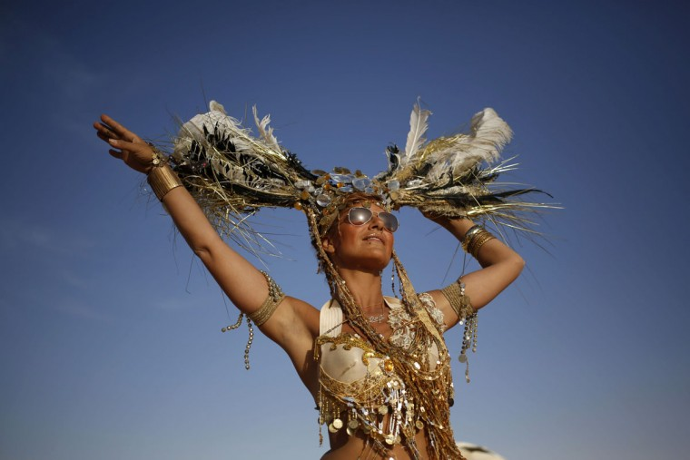 An Israeli woman dances during the 2015 Midburn festival in the Negev Desert near the Israeli kibbutz of Sde Boker on May 22, 2015. (GALI TIBBON/AFP/Getty Images)