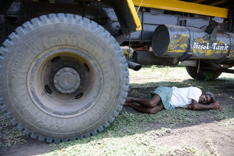 An Indian man rests under a transport vehicle on the outskirts of Hyderabad on May 25, 2015. More than 430 people have died in two Indian states from a days-long heatwave that has seen temperatures nudging 50 degrees Celsius (122 degrees Fahrenheit), officials said May 25. Officials warned the toll was almost certain to rise, with figures still being collected in some parts of the hard-hit Telangana state in the south of the country, and with no end in sight to the searing conditions. (Noah Seelam/AFP/Getty Images ORG XMIT: