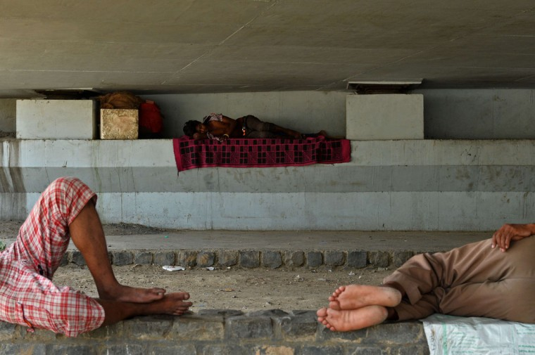 Indian men sleep in the shade under a bridge in New Delhi on May 27, 2015. More than 1,100 people have died in a blistering heatwave sweeping India, authorities said May 27, 2015, as forecasters warned searing temperatures would continue. (Chandan Khanna/AFP/Getty Images)