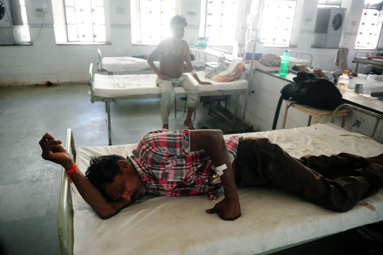 Indian diarrhoea patient Hari Sankar Gupta lies on a bed in a government hospital in Allahabad on May 28, 2015, as scorching weather conditions continue across India. Hospitals in India were struggling to cope with an influx of victims of a blistering heatwave that has claimed nearly 1,500 lives in just over a week. (Sanjay Kanojia/AFP/Getty Images)