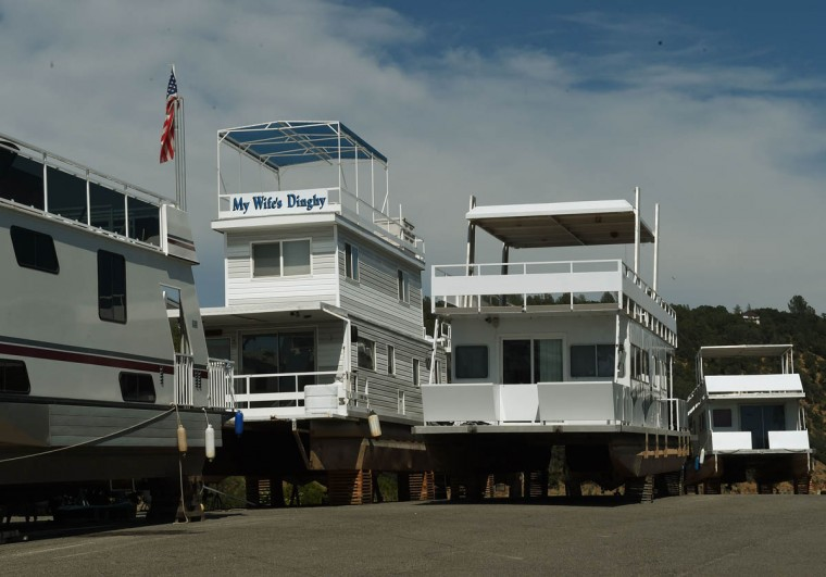 Houseboats sit in storage beside the Oroville Lake reservoir which is now at less than 25 percent capacity as a severe drought continues to affect California on May 25, 2015. California has recently announced sweeping statewide water restrictions for the first time in history in order to combat the region's devastating drought, the worst since records began. (Mark Ralston/AFP/Getty Images)