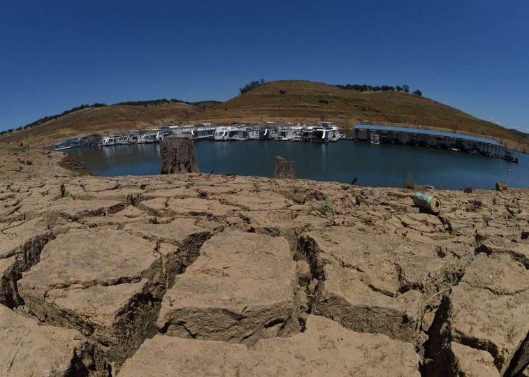 Dried mud and the remnants of a marina at the New Melones Lake reservoir which is now at less than 20% capacity as a severe drought continues to affect California on May 24, 2015. California has recently announced sweeping statewide water restrictions for the first time in history in order to combat the region's devastating drought, the worst since records began. (Mark Ralston/AFP/Getty Images)