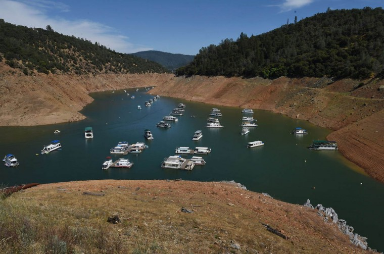 Houseboats are moored on a shrinking arm of the Oroville Lake reservoir which is now at 25 percent capacity as a severe drought continues to affect California on May 24, 2015. Local media is reporting that California officials are now looking to Australia for advice on how to deal with long term drought as the state enters its fourth year of severe drought. (Mark Ralston/AFP/Getty Images)