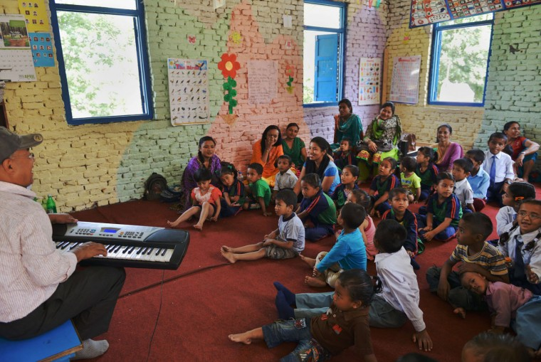 Nepalese students sing a song in the classroom of a school in Bhaktapur on the outskirts of Kathmandu on May 31, 2015. Schools are reopening in Nepal following a devastating earthquake on April 25, 2015 which killed over 8,600 people, and damaged nearly 8,000 schools and 30,000 classrooms. (Prakash Mathema/AFP/Getty Images)