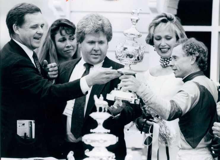 Owner John Ed Anthony, left, trainer Tom Bohannan, center, and jockey Chris McCarron, right, pose with the winner's trophy after McCarron guided Pine Bluff to victory in the 1992 Preakness. (Baltimore Sun, 1992)