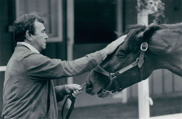 Trainer Ron McAnally with his horse Hawster after a morning gallup at Pimlico. (Bo Rader/Baltimore Sun, 1989)