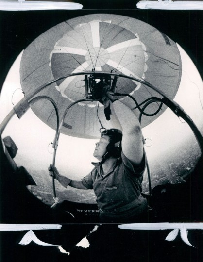 Reds Horrocks, pilot of the Sunpapers balloon, turns up the gas to get over downton during the Preakness Week balloon race. (J. Pat Carter/Baltimore Sun, 1979)