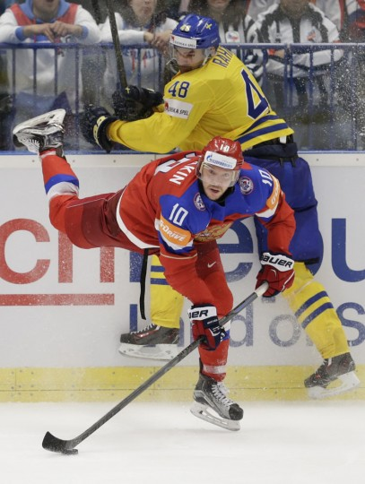 Russia's Sergei Mozyakin, bottom, struggle for the puck with Sweden's Daniel Rahimi during the Hockey World Championships quarterfinal match between Sweden and Russia, in Ostrava, Czech Republic, Thursday, May 14, 2015. (AP Photo/Sergei Grits)