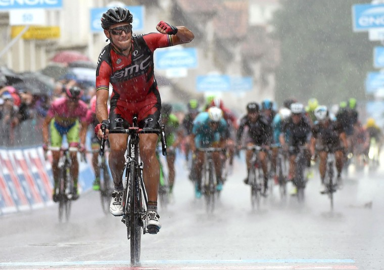 Belgium's Philippe Gilbert celebrates as he crosses the finish line to win the 12th stage of the Giro d'Italia, Tour of Italy cycling race from Imola to Vicenza, Italy, Thursday, May 21, 2015. Alberto Contador extended his overall lead ahead of Fabio Aru to 17 seconds while Philippe Gilbert won the rainy 12th stage of the Giro d'Italia on Thursday. (Daniel Dal Zennaro/ANSA via AP)