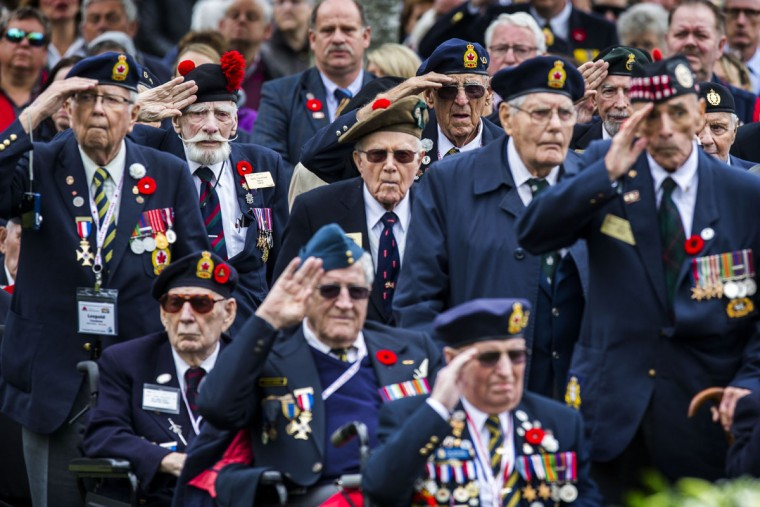 Canadian World War II veterans salute as they attend a memorial ceremony in honor of Canadian soldiers who died during the liberation of the Netherlands in 1945 at the Canadian War Cemetery in Holten, east Netherlands, Monday, May 4, 2015. Canadian Prime Minister Stephen Harper is in the Netherlands to mark the 70th anniversary of the Liberation of the Netherlands. (AP Photo/Vincent Jannink)