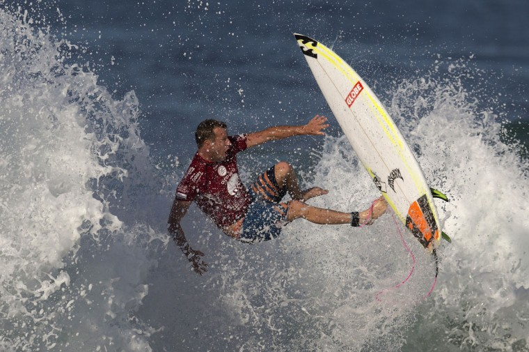 Australia's Taj Burrow competes in the 2015 Oi Rio Pro World Surf League competition at Barra da Tijuca beach in Rio de Janeiro, Brazil, Tuesday, May 12, 2015. (AP Photo/Leo Correa)