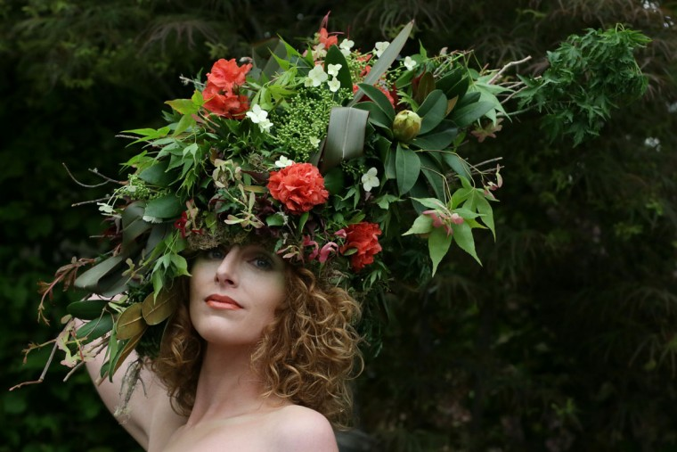 Katherine Warwick Adkins wears a floral hat and dress made by floral stylists Okishima & Simmonds at the Chelsea Flower Show in London, Monday, May 18, 2015. The Chelsea Flower Show will take place between May 19 - 23. (AP Photo/Tim Ireland)