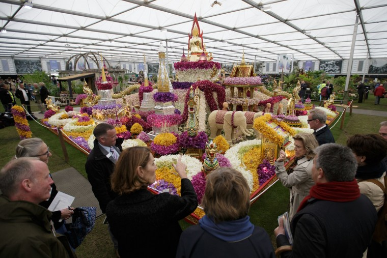 People view the Nong Nooch Tropical Botanical Garden, at the Chelsea Flower Show in London, Monday, May 18, 2015. Horticulturists from around the world are displaying their garden designs at the Royal Hospital in Chelsea, London, and the premier garden and social event opens to the public on Tuesday.(AP Photo/Tim Ireland)
